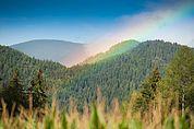 Rebenbogen über den Bergen bei Gufidaun