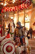 Kind auf dem Karusell