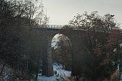 Brücke der Fleimstalbahn bei Pinzon